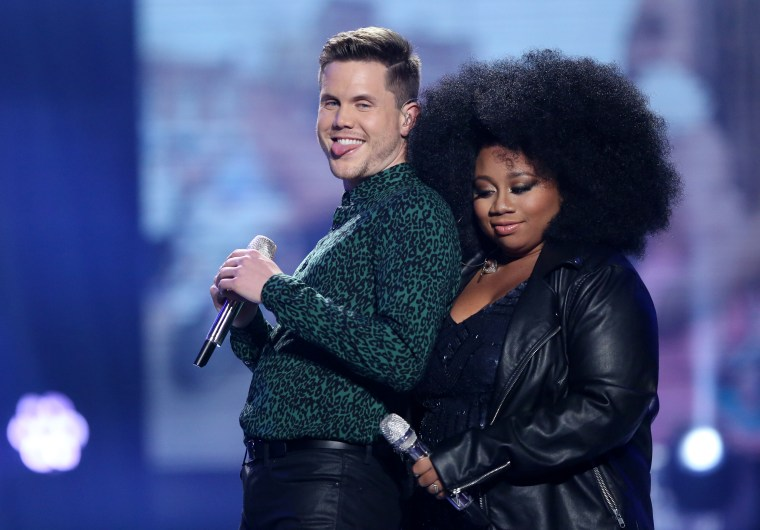"""Trent Harmon, left, and La'Porsha Renae appear at the """"American Idol"""" farewell season finale at the Dolby Theatre on Thursday, April 7, 2016, in Los Angeles."""