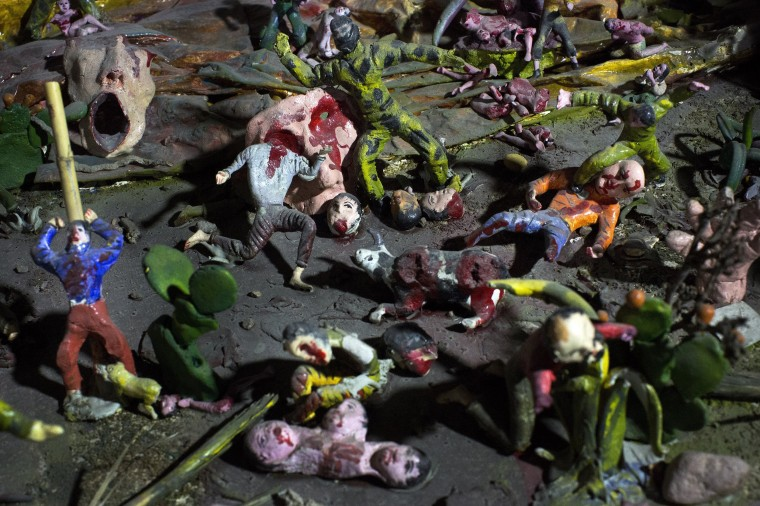 Image: Sculptures recreating a massacre during Peru's two decades of political violence