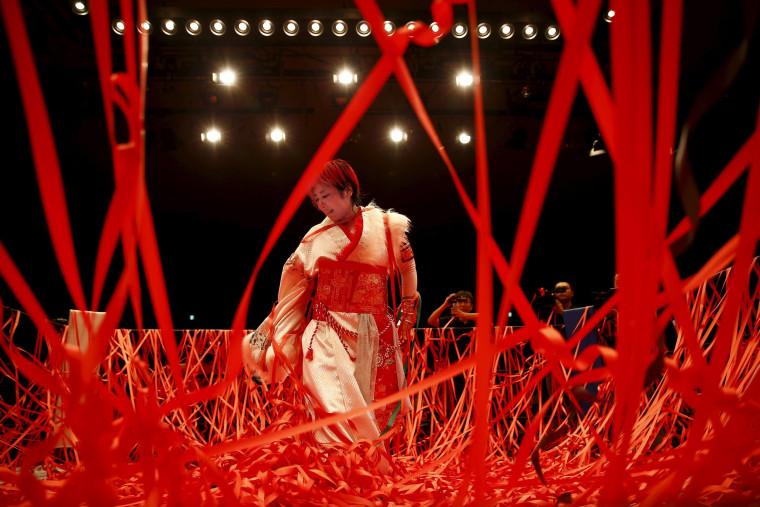 Image: Ticker tape confetti rains on wrestler Act Yasukawa after her last match before retirement