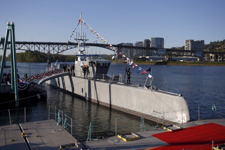 """Image: The autonomous ship """"Sea Hunter"""", developed by DARPA, is shown docked in Portland, Oregon before its christening ceremony"""