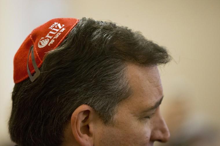 """Image: Ted Cruz wears a \""""Cruz 2016\"""" yarmulke as he speaks to Jewish community leaders"""