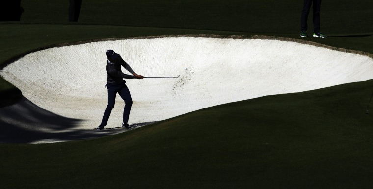 Image: Charl Schwartzel, of South Africa, hits out of a bunker