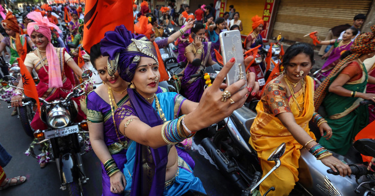 Image: Indian people in traditional clothes participate in the procession to celebrate the Gudi Padwa