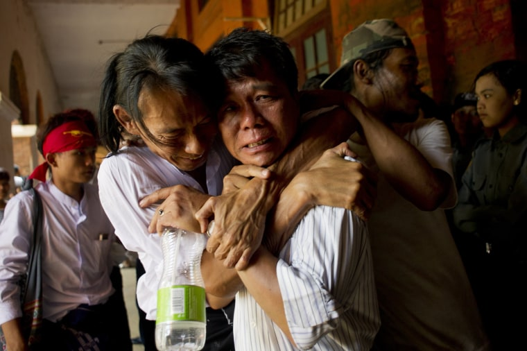 Image: Newly-released political student protester and family members cry after being reunited