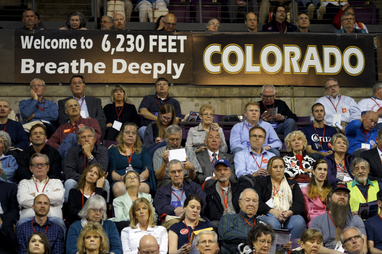 Image: Attendees at the Colorado Republican state convention listen to a speaker at the event in Colorado Springs