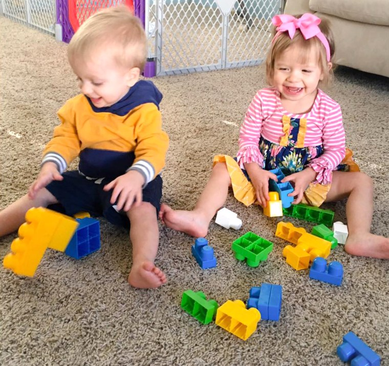 Image of the twin children whose mom warned of side-by-side crib danger