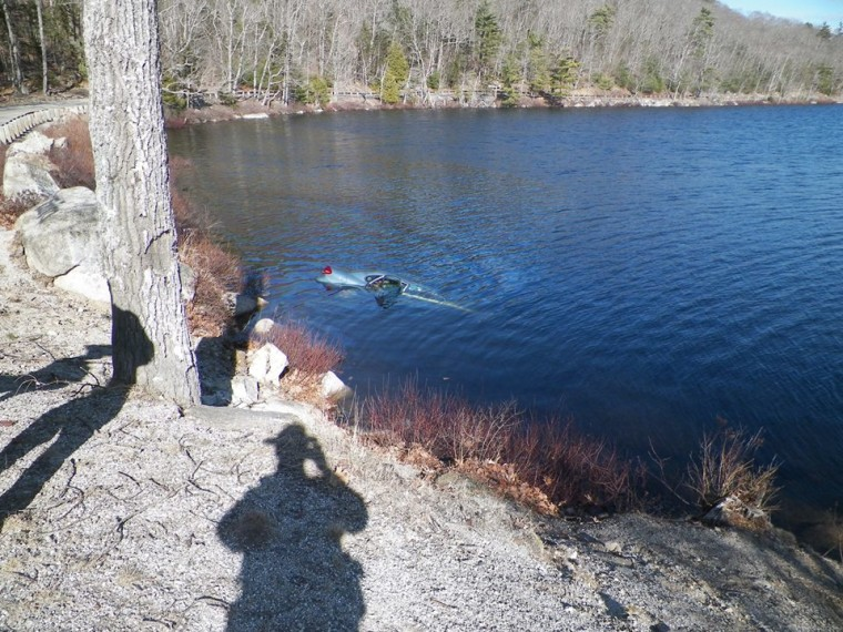 Mandi Parker's car sinking in a Maine pond after her familiy was rescued by strangers