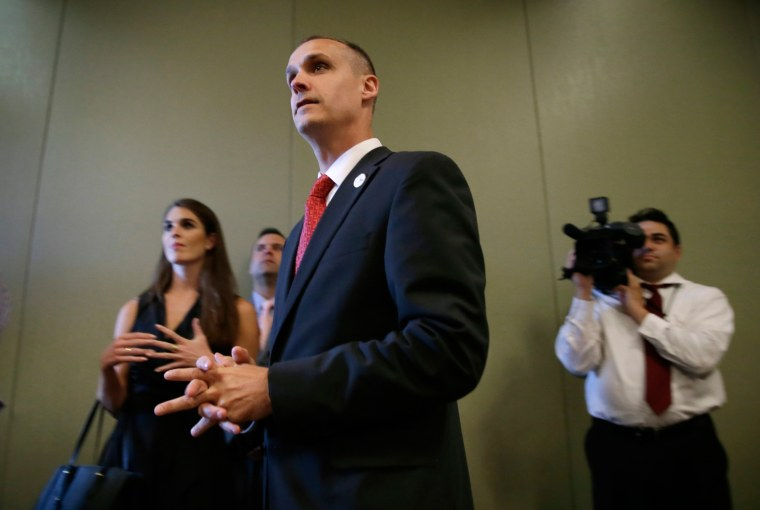 Image: Campaign manager Corey Lewandowski looks on as Republican presidential candidate Donald Trump speaks
