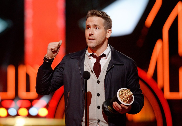 "Image: Actor Ryan Reynolds accepts Best Comedic Performance for ""Deadpool"""
