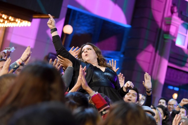 Image: Actress Melissa McCarthy, winner of the Comedic Genius award, crowd-surfs to the stage