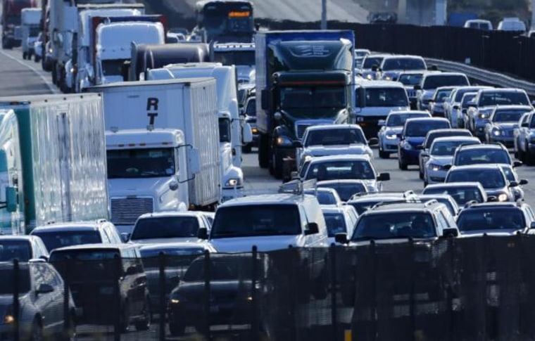 Automobile traffic backs-up as it travels  north from San Diego to Los Angeless along Interstate Highway 5 in California