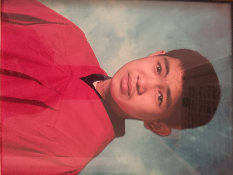 Yong Xin Huang graduating from middle school several months before being killed.