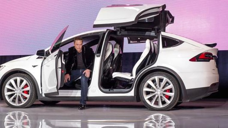 Elon Musk, chairman and chief executive officer of Tesla Motors Inc., exits the Model X sport utility vehicle (SUV) during an event in Fremont, California, U.S., on Tuesday, Sept. 29, 2015.