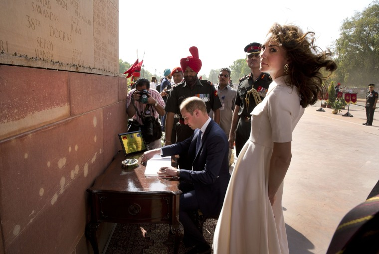 Image: Britain's Prince William and his wife Kate, the Duchess of Cambridge visit the India Gate war memorial