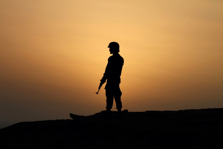 Image: A Pakistan Navy soldier stands guard at a hilltop position near Gwadar port