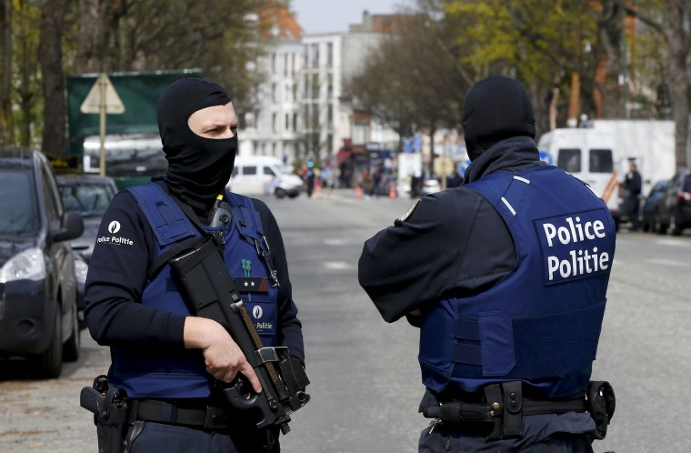 Image: Belgium police officers secure the access during a police operation in Etterbeek