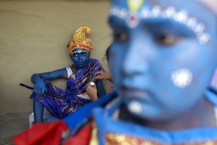 Image: A Hindu girl has her face painted before taking part in a ritual as part of the annual Shiva Gajan religious festival on the outskirts of Agartala