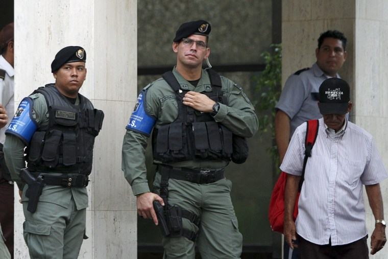 Image: Police officers stand guard at the entrance of Mossack Fonseca