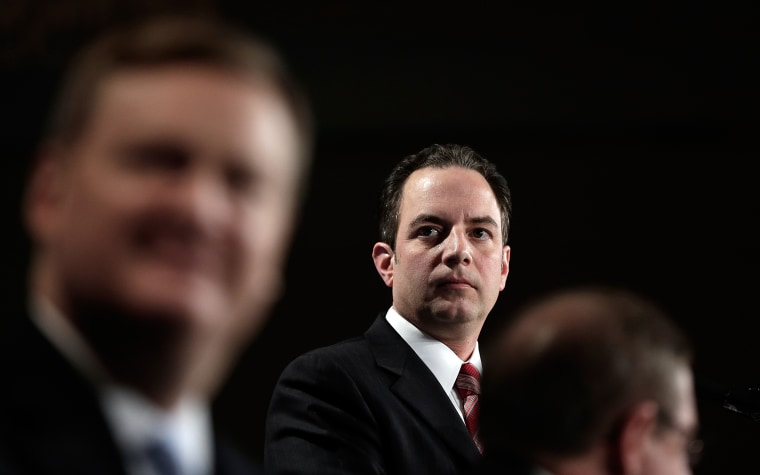 Image: Republican National Committee Chairman Reince Priebus (C) speaks