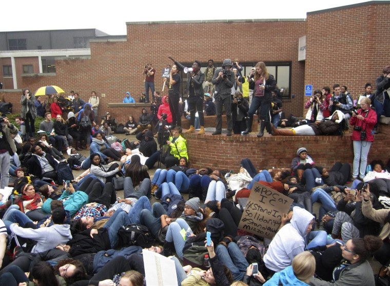 Protesters encourage students to lay down as part of a 'die-in' this afternoon at Ithaca College in New York on Nov. 11.