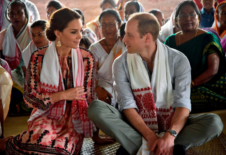 "Image: Britain's Prince William and his wife Catherine, the Duchess of Cambridge, visit a ""Namghar"", an Assamese site of congregational worship, in Panbari village in Kaziranga"