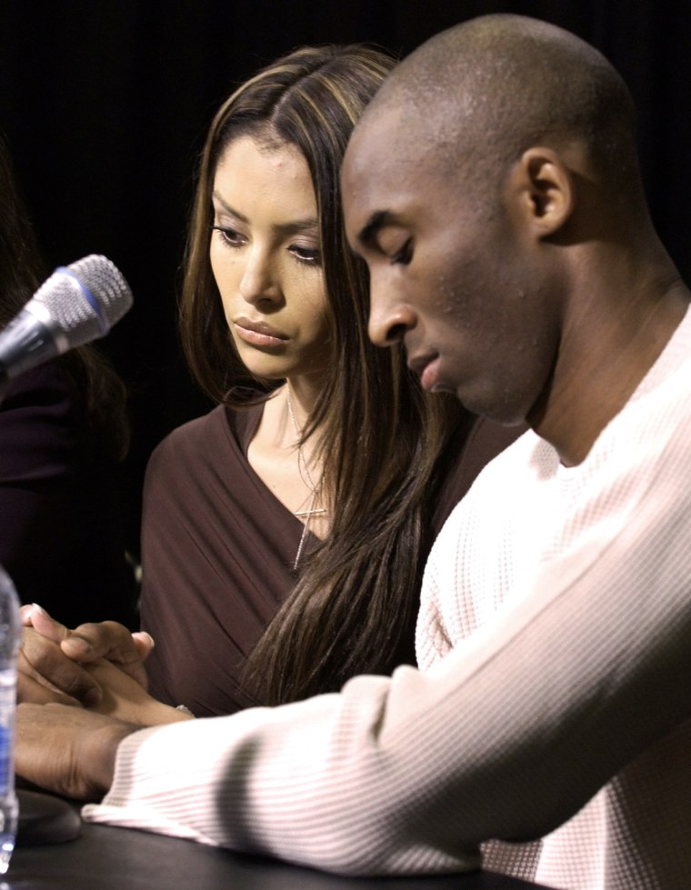 Image: File photo of Los Angeles Lakers basketball star Kobe Bryant holding hands with his wife Vanessa as he admits to adultery at a news conference in Los Angeles