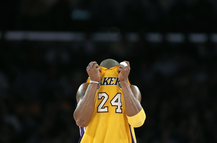 Image: Los Angeles Lakers Kobe Bryant reacts during their NBA basketball game against the Sacramento Kings in Los Angeles