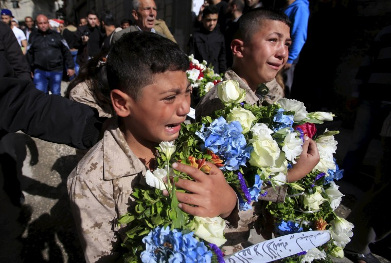 Image: Boys react during the funeral of Fathi Zaydan, a Fatah official responsible for the Palestinian camp of Mieh Mieh, after an explosion that killed him yesterday, during his funeral in Mieh Mieh Palestinian refugee camp, near the port-city of Sidon