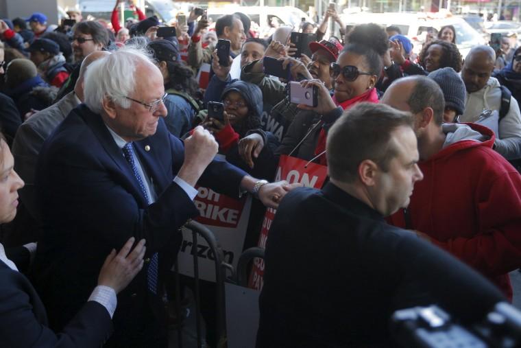Image: U.S. Democratic presidential candidate and U.S. Senator Bernie Sanders greets Communications Workers of America (CWA) workers striking against Verizon in Brooklyn