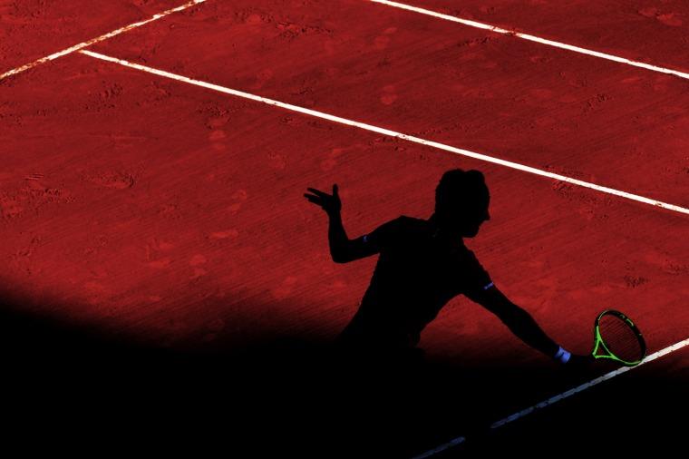 Image: France's Richard Gasquet hits a return to France's Lucas Pouille