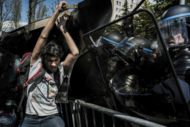 Image:  People clash with riot police during a demonstration against the government's planned labor reform