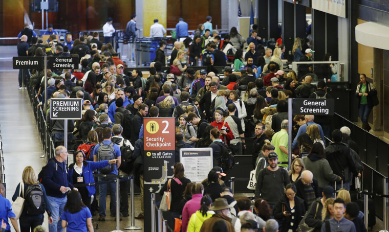 Image: Travelers wait in line for security screening at Seattle-Tacoma International Airport