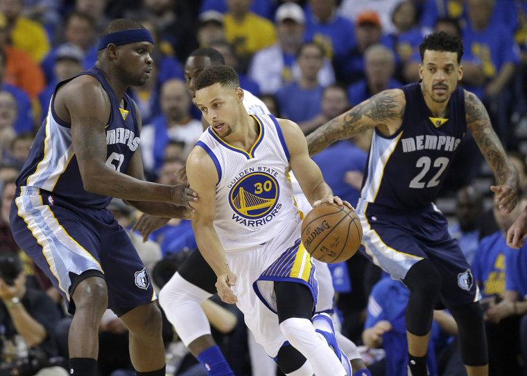 Image: Golden State Warriors guard Stephen Curry, no.30, dribbles