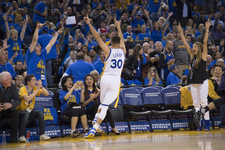 Image: Warriors guard Stephen Curry, no. 30, celebrates after making his 400th three-point basket