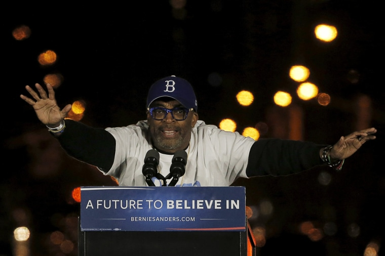 Image: Director Spike Lee speaks at a campaign rally for U.S. Democratic presidential candidate Bernie Sanders in Washington Square Park in the Greenwich Village neighborhood of New York City