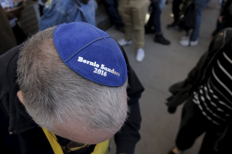 Image: A supporter shows his Yamaka at a campaign rally with U.S. Democratic presidential candidate Bernie Sanders in Washington Square Park in the Greenwich Village neighborhood of New York City