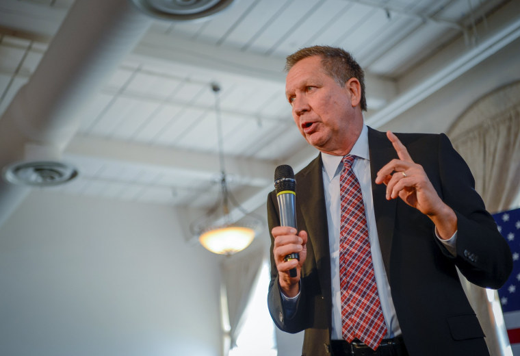 Image: U.S. Republican presidential candidate, Ohio Gov. John Kasich, addresses a packed room at a town hall meeting in Savage, Maryland
