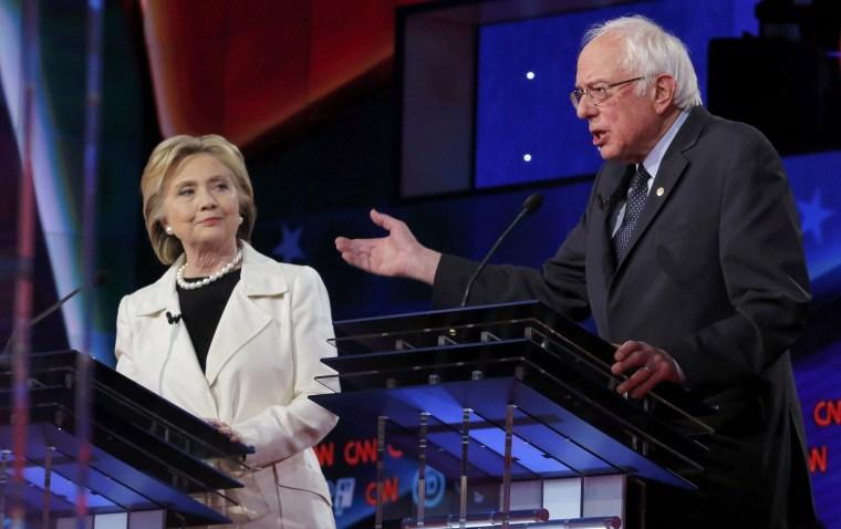 Image: Democratic U.S. presidential candidate Clinton listens to Sanders speak during a Democratic debate in New York