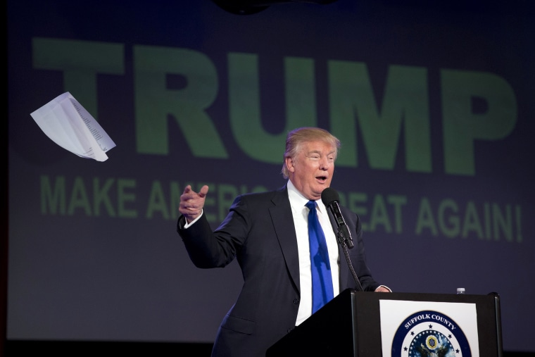 Image: Donald Trump tosses his notes as he speaks during a Suffolk County Republican Committee