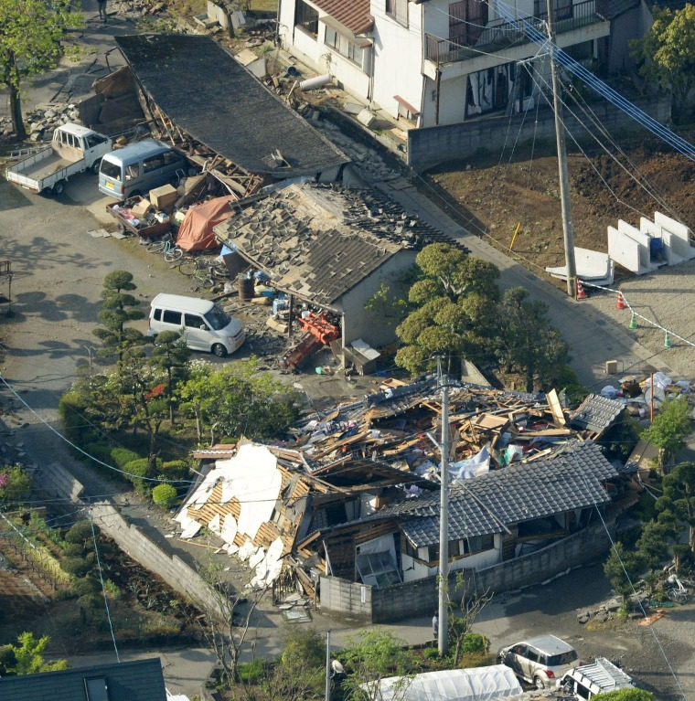 Image: Houses with collapsed rooftops and scattered debris left in the aftermath of the earthquake