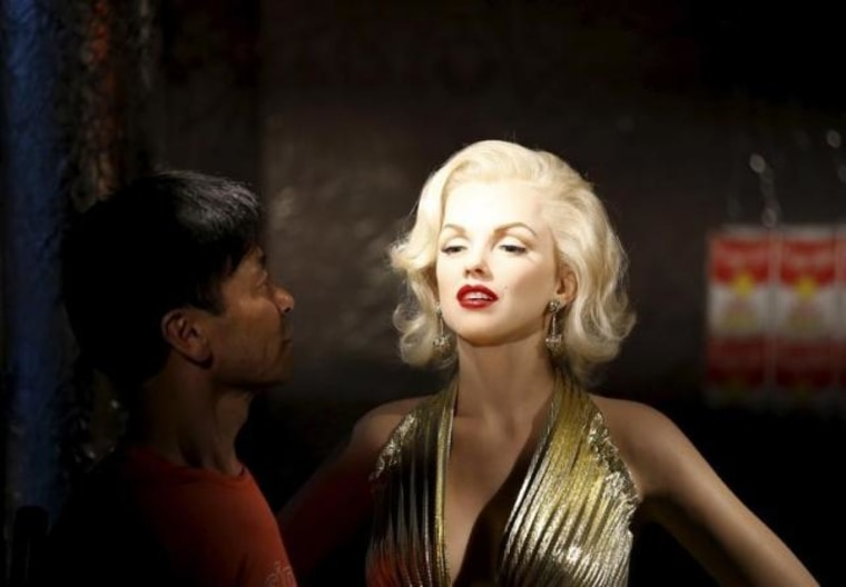 A man looks at the wax figure of Marilyn Monroe at Grevin Wax Museum in central Seoul