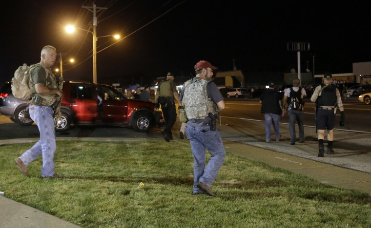 Heavily armed civilians with a group known as the Oath Keepers arrive in Ferguson, Mo., on Aug. 11, 2015.