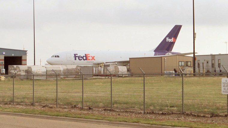 A stowaway taken into to custody by police at Lubbock Preston Smith International Airport has been identified as a Memphis FedEx airport ground crew employee who fell asleep on the plane before it took off for Lubbock.