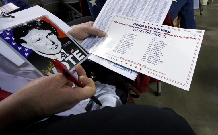 Image: A delegate supporting Republican U.S. presidential candidate Donald Trump looks over documents at the Colorado Republican state convention in Colorado Springs