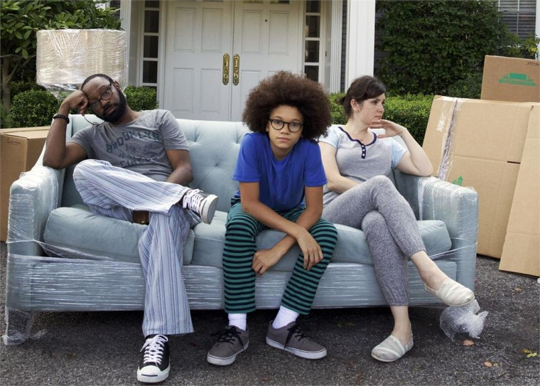 Neslan Ellis as Mack Burns, Armani Jackson as Clark Burns, and Melanie Lynskey as Gina McNulty-Burns in LITTLE BOXES.