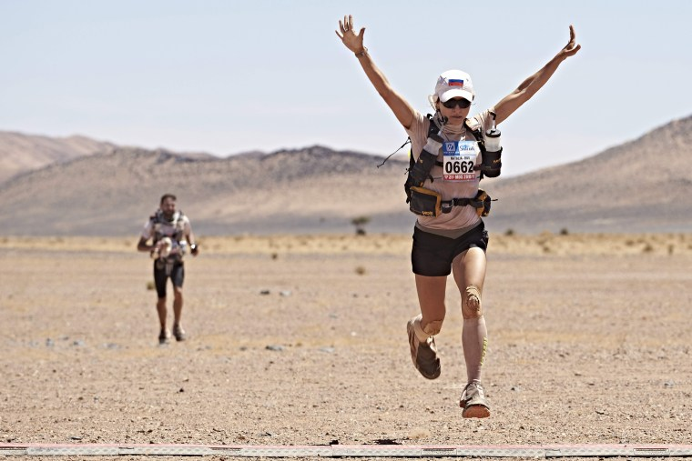 Image: Russian Natalia Sedykh celebrates after crossing the finish line