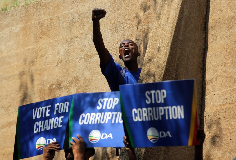 Image: A demonstrator voices his support after a protest march to the Constitutional Court in Johannesburg