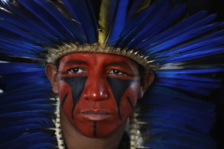 Image: A member of the indigenous Pataxo group participates in a demonstration