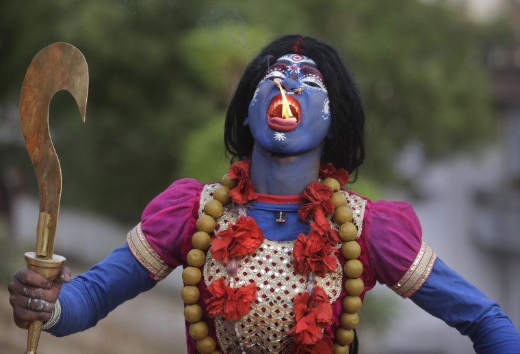 Image: An Indian man dressed as Hindu Goddess Kali