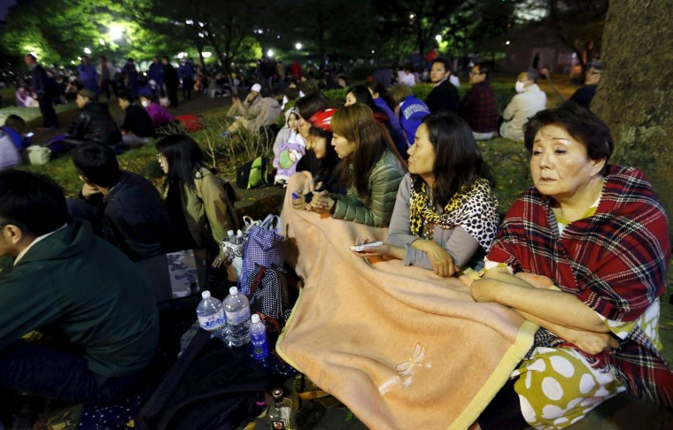 Image: Evacuated residents gather at Shirakawa park after an earthquake in Kumamoto, southern Japan